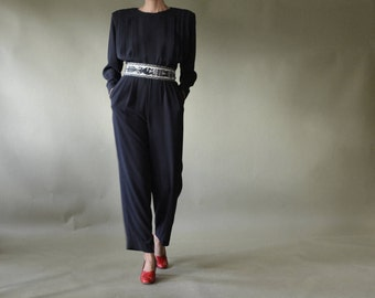 80s black jumpsuit with pleating and strong shoulder // US 6