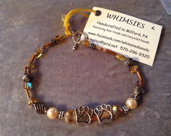 Glass beaded bracelet, size LARGE. Gold beads, silver findings, dog or cat paws, Boho, hippie, fair trade, gift, free shipping. Made in USA.