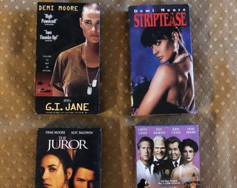 Vintage lot of 4 Demi Moore Movies. G.I. Jane. Nothing but Trouble. Striptease. The Juror.