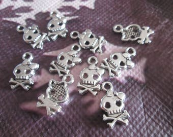 10 pattern skull charms and a small knot 16 x 8 mm