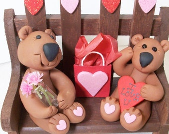 Valentine love Bears on a bench: Polymer clay bears with hearts.