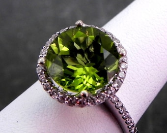 AAAA Peridot Natural Untreated Round   11.63mm  7.00 Carats   in 14K white gold Halo ring with .50 carats of diamonds MMM