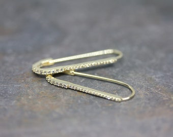 Pave' safety pin earrings in gold