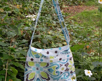 Upcycled tiny purse. Blue and Green floral print with a polka dot lining.