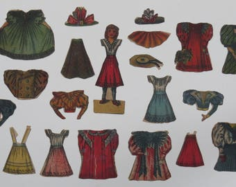 Antique Edwardian cut-out paper doll with clothes dating from around 1900