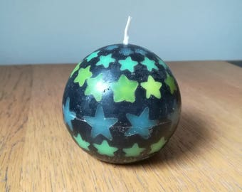 Black ball candle with fluorescent stars scented bubblegum