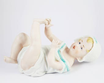 Vintage Porcelain Piano Baby Figurine by Andrea 7536