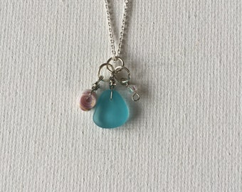 Blue Sea Glass Necklace With Crystal Bead And Shell Charm On A Silver Chain