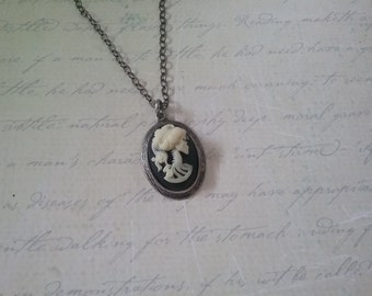 Small antiqued silver skeleton cameo