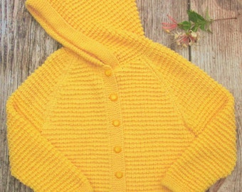 Little girl's childs hand knitted yellow cashmere cotton blend jacket cardigan hoodie coat with a pixie hood.