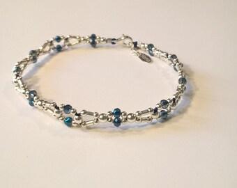 Bracelet woven way retro link in silver and blue swarovski crystal. Woven bracelet fashion retro silver blue swarovski crystal link