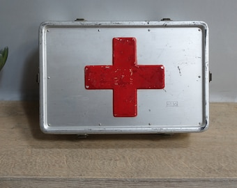 Old box of emergency first aid Red Cross vintage Old first aid box red cross vintage air force air force