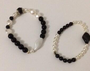Bracelets elastic white puck or black handmade.