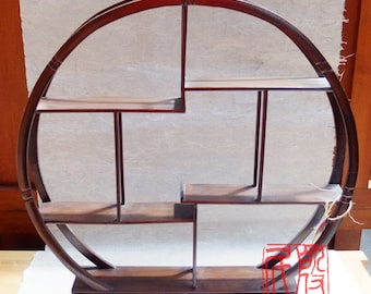 Chinese style curio stand made of solid wood.
