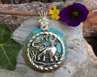Tibetan Silver Wirewrapped Elephant Pendant on Howlite
