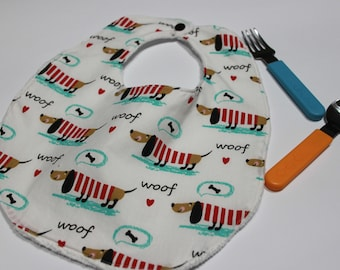 Cotton bib with dachshunds and hearts on white background
