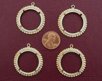 four gold plated 25 cent coin mounting
