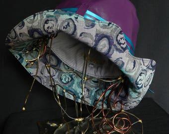 Purple leatherette rain hat, wave shaped fancy edge