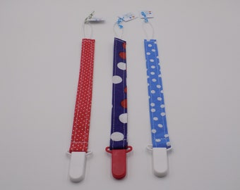 Blue, Red, and White Dot Pacifier Clip Set