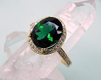AAAA Green Tourmaline  10x8mm  3 Carats 14K Yellow gold Halo engagement w/ .30 Cts of diamonds.  3005