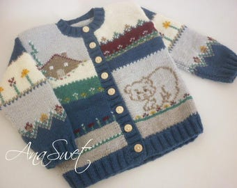Hand knit baby cardigan with embroidery.