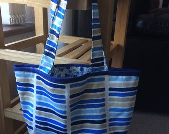 Two-way bag, handmade, contrasting interior extends to hold more.