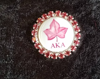 Sorority badge reels with customized pink ice inspired stones.   Sorority gift,graduation, AKA gift.