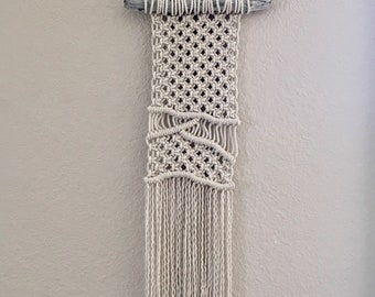 Macrame wall hanging with driftwood