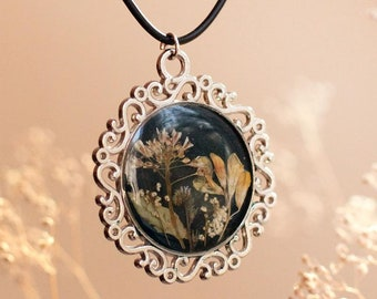 Pendant with flowers and herbs