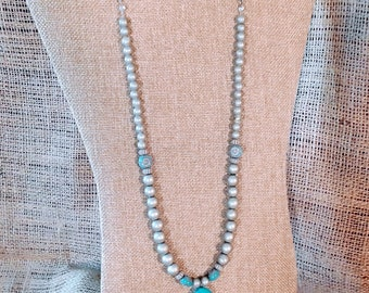 Soft silver tone and translucent turquoise colored, matinee length necklace