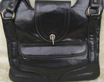 Vintage 1950's Black Leather Handbag w/ Red interior & clear cosmetic pocket inside..
