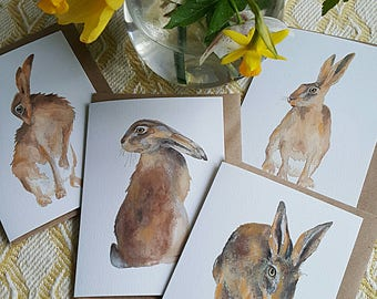 Hare watercolours. Four images to choose from. Hare card. hare watercolour card. hand painted hares. Norfolk hares. painting of a hare.