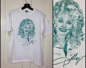 1980's Dolly Parton country music legend in turquoise glitter print t-shirt size medium 19x25 all cotton