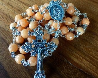 Beautiful handmade large rosary with pastel orange jade beads, mother and child center and ornate crucifix.