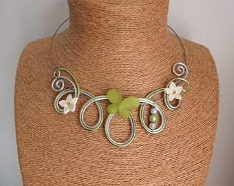 Aluminum and its flowers, butterfly, Apple green and silver necklace.
