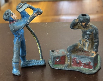 2 Vintage MANOIL DIMESTORE LEAD Figures Farmer Sharpening Scythe and Soldier Toy