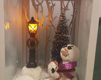 Christmas Cannibal/ christmas/ snowman/ hilarious/ dark christmas humor/ lantern/ snow/ lamp post/ dark humor