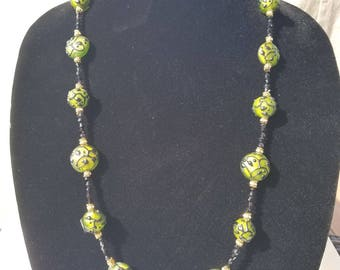 Bright green necklace with green beads embossed with black