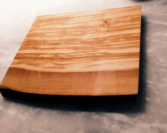 Olivewood cutting board, finished smooth with foodsafe waxes and oils