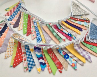 12ft bunting comprising of 25 small flags in a mix of bright fabrics, great for any party, bottom row available