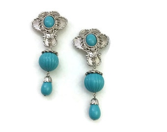 Barrera for Avon turquoise-colored beads and silver-toned drop clip-on earrings: 3.25 inches long. Like-new condition.