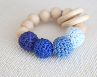 Baby blue, carolina blue, persian blue, ultramarine blue teething ring toy with crochet wooden beads. Rattle for baby.