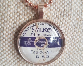 Sylko pendant / sewing theme gift / rose gold tone cabochon pendants / upcycled cotton thread labels / colour EAU DE NIL / oops