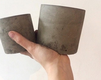 Set of a small and medium size concrete planters