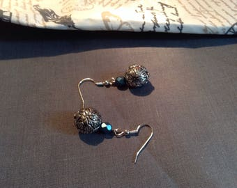 Dangling earrings with antiqued silver bead and a blue faceted bead