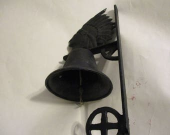Antique circa 1890's to 1930's era cast Iron school bell in the form of a Native American.