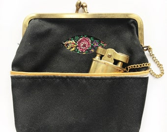 Mid Century tapestry change purse or cigarette holder with lighter. Arrow purse lighter.