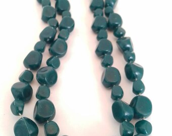 Green plastic vintage beaded necklace.