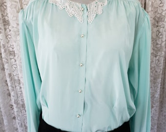La Blouse green blouse with lace collar pearl buttons