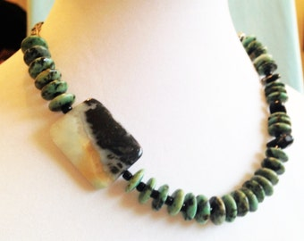 AFRICAN TURQUOISE Rondelles accent an impressive rectangular stone.